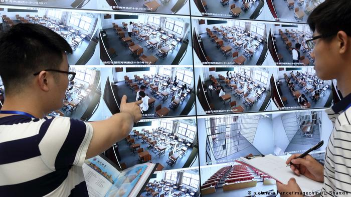 Students undergo facial recorgnition, fingerprint verification, metal detectors and take exams in radio-shielded rooms