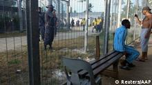 Police beginning to enter the Manus Island detention center in Papua New Guinea to expel refugees (Reuters/AAP)