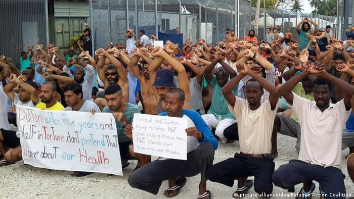 Man protest inside the Manus Island detention center