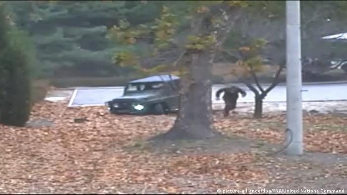 man fleeing across border between two Koreas