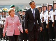 German Chancellor Angela Merkel and U.S. President Barack Obama walk along the guard of honour in Baden-Baden