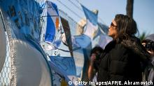 A relative of missing submariner Celso Oscar Vallejos looks at supportive messages for the 44 crew members of Argentine missing submarine hanging outside Argentina's Navy base in Mar del Plata, on the Atlantic coast south of Buenos Aires, on November 23, 2017. Argentina's navy said it was investigating an unusual noise detected in the South Atlantic hours after it last communicated with a missing submarine, but refused to confirm whether it indicated an explosion. The ARA San Juan would have had enough oxygen for its crew to survive underwater in the South Atlantic for seven days since its last contact, according to officials. At 0730 GMT November 22, that time had elapsed. / AFP PHOTO / EITAN ABRAMOVICH (Photo credit should read EITAN ABRAMOVICH/AFP/Getty Images)