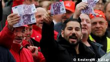 23.11.2017 *** Thyssenkrupp steel workers, holding fake 500-euro banknotes, protest against the planned combination of the group's European steel operations with those of Tata Steel of India, in Andernach, Germany, November 23, 2017. REUTERS/Wolfgang Rattay