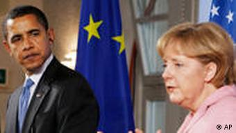 President Barack Obama looks on as German Chancellor Angela Merkel speaks to reporters at city hall in Baden-Baden, Germany, Friday, April 3, 2009. (AP Photo/Charles Dharapak)