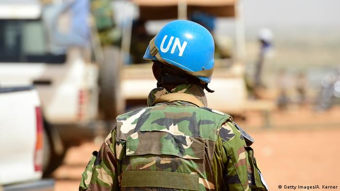 A Bangladeshi UN peacekeeper walks by a car in Mali (Getty Images/A. Kerner)