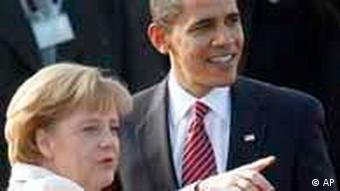 German Chancellor Angela Merkel points into the distance as she speaks with US President Barack Obama