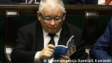 Jaroslaw Kaczynski reading the book Atlas of Cats (Reuters/Agencja Gazeta/S. Kaminski)