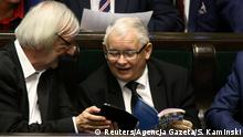 Jaroslaw Kaczynski, leader of the ruling party Law and Justice, and deputy speaker Ryszard Terlecki laugh as they attend a Parliament session in Warsaw, Poland, November 24, 2017. Agencja Gazeta/Slawomir Kaminski via REUTERS ATTENTION EDITORS - THIS IMAGE WAS PROVIDED BY A THIRD PARTY. POLAND OUT. NO COMMERCIAL OR EDITORIAL SALES IN POLAND