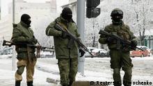 Armed men wearing masks block off a street in the centre of rebel-controlled city of Luhansk, Ukraine November 22, 2017. REUTERS/Alexander Ermochenko