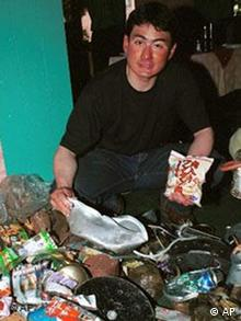 Japanese mountaineer Ken Noguchi shows garbage collected from Everest during an earlier expedition