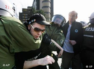 Police arresting a protester opposed to the NPD party convention in Berlin