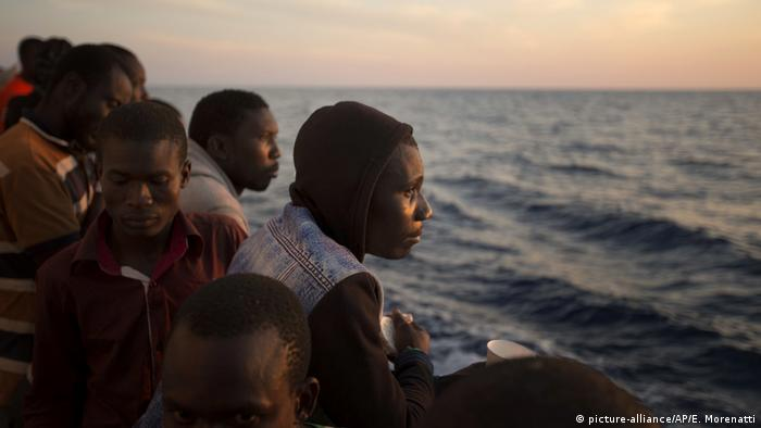 Migrants on the deck of a rescue vessel in the Mediterranean