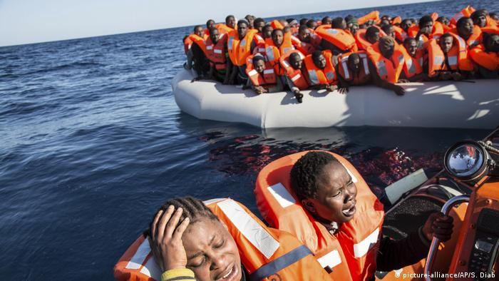 African refugees in rubber boats on the Mediterranean