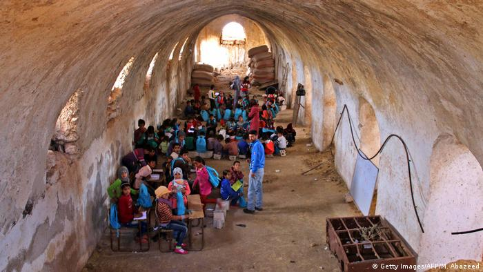 Children in a barn in Syria (Getty Images/AFP/M. Abazeed)