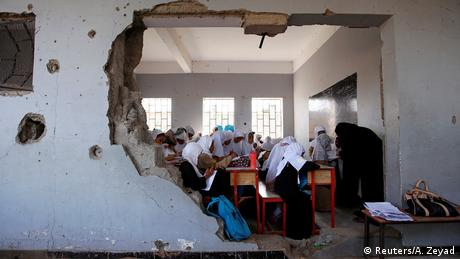 Girls with white headscarves in a ruined classroom in Yemen (Reuters/A. Zeyad)