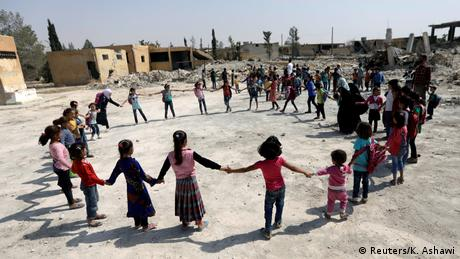 Children playing at a school in al-Saflaniyeh (Reuters/K. Ashawi)