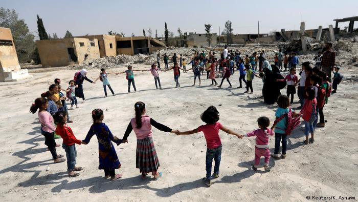 Children play in the Aleppo countryside