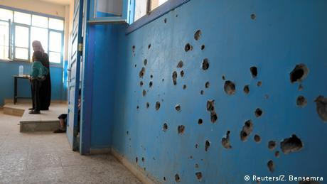 Bullet holes in a wall of a school in Syria (Reuters/Z. Bensemra)a