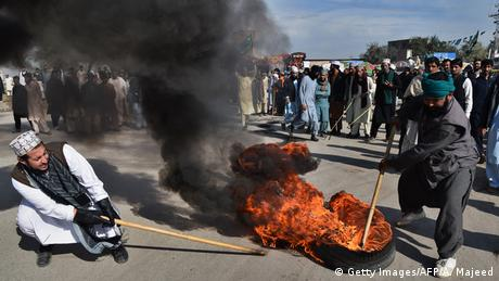Protesters burn tires during a protest in Peshawar on November 25, 2017.