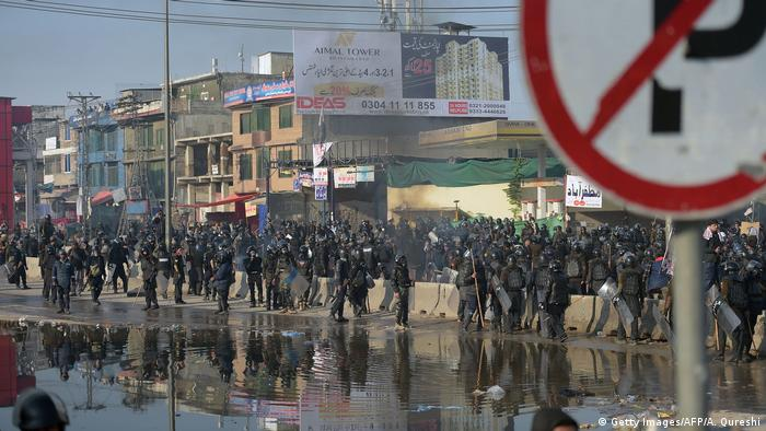 Riot policemen gather during a clash with protesters of the Tehreek-i-Labaik Yah Rasool Allah Pakistan (TLYRAP) religious group.