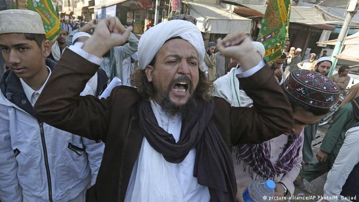 A protester shouts in support of his party as other supporters block main highway connecting the capital city Islamabad with other cities.
