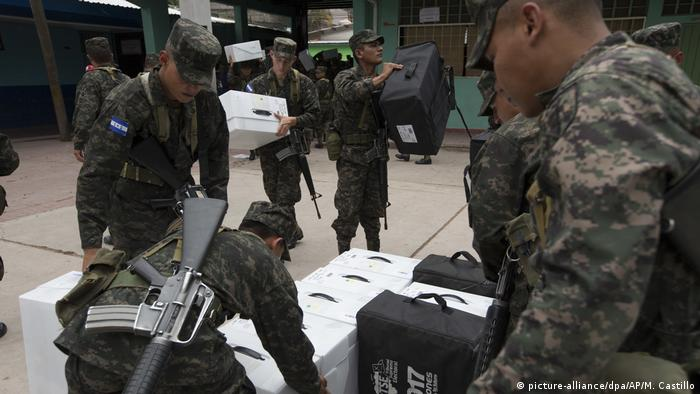 Military personnel watch over cast ballots, as political and judicial leaders maintain that Honduras' electoral process is legally sound