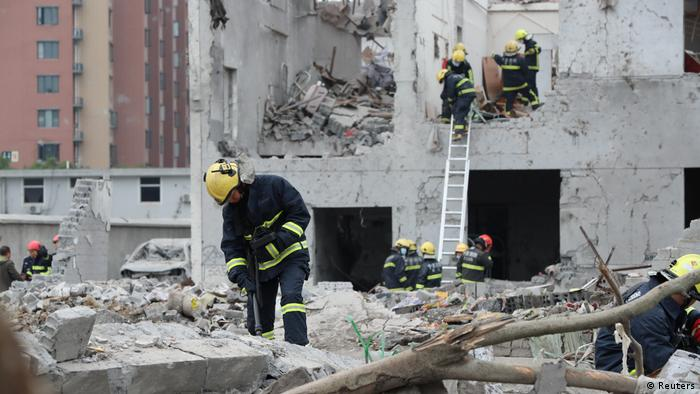 Rescue workers comb through the rubble