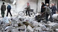 DAMASCUS, SYRIA - NOVEMBER 23: People inspect the rubble after Assad regime's warplane carried out airstrikes over Arbin town of the Eastern Ghouta region in Damascus, Syria on November 23, 2017. Diaa Al Din / Anadolu Agency  