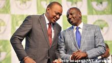 Kenya's president-elect, Uhuru Kenyatta (L) with his running mate William Ruto wait to receive their certificates of election October 30, 2017 after they were announced winners of a repeat presidential poll by the Independent Electoral and Boundaries Commission chairman. Kenyan President Uhuru Kenyatta was declared victor of the country's deeply divisive elections on October 30, taking 98 percent of the ballots cast in a poll boycotted by his rival Raila Odinga, sparking fears of further violence in flashpoint opposition strongholds. / AFP PHOTO / TONY KARUMBA (Photo credit should read TONY KARUMBA/AFP/Getty Images)