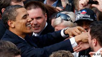 US President Barack Obama greets supporters after delivering a public speech in Prague