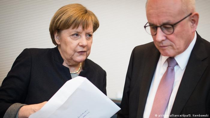 Angela Merkel speaks to Volker Kauder