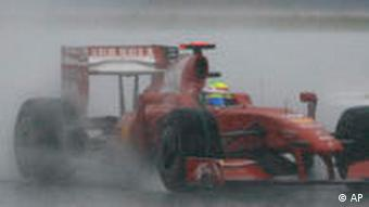 Ferrari Formula One driver Felipe Massa of Brazil controls his car in a heavy down pour in Sepang outside Kuala Lumpur, Malaysia, Sunday, April 5, 2009, during the rain-shortened Malaysian Grand Prix. This is the second race this season that Ferrari has finished with no points.