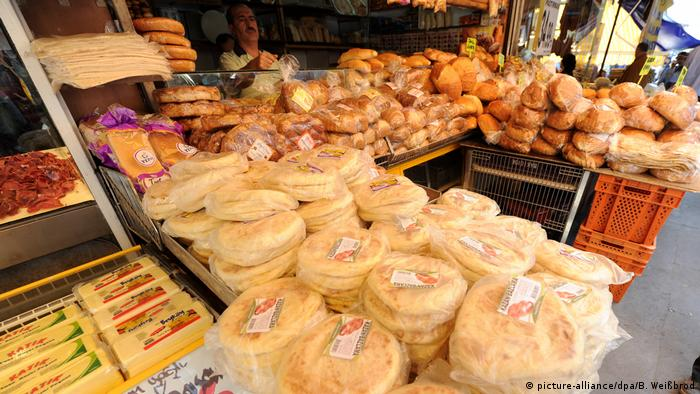 A baker and his wares at a market in Ankara