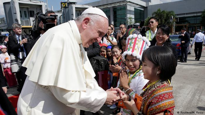 Pope Francis is welcomed as he arrives at Yangon International Airport