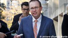 Mick Mulvaney returns to the Consumer Financial Protection Bureau in Washington, Monday afternoon, Nov. 27, 2017. (AP Photo/Jacquelyn Martin) |