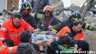 Italian rescue teams retrieve a person from a building which collapsed following an earthquake, in L'aquila, Central Italy, 06 April 2009. At least nine people were killed 06 April in the central Italian region of Abruzzo when a magnitude-5.8 earthquake struck, police said. Five of the dead were from Castelnuovo, where dozens of houses and a church collapsed, they said in their initial toll from the disaster, which did not include four children that Italian media reported had died in a hospital in L?Aquila, Abruzzo's capital. Numerous buildings collapsed in L?Aquila, where people were searching for survivors in the rubble of a house and student dormitory in the city?s historic centre. EPA/PERI - PERCOSSI +++(c) dpa - Report+++
