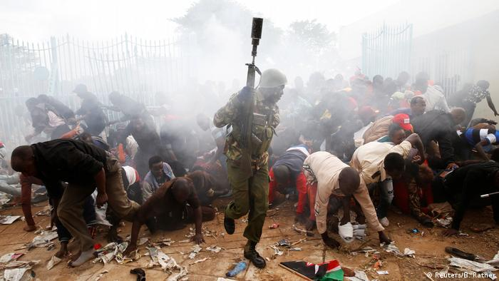 A police officer fires tear gas at the inauguration of President Uhuru Kenyatta (Reuters/B. Ratner)