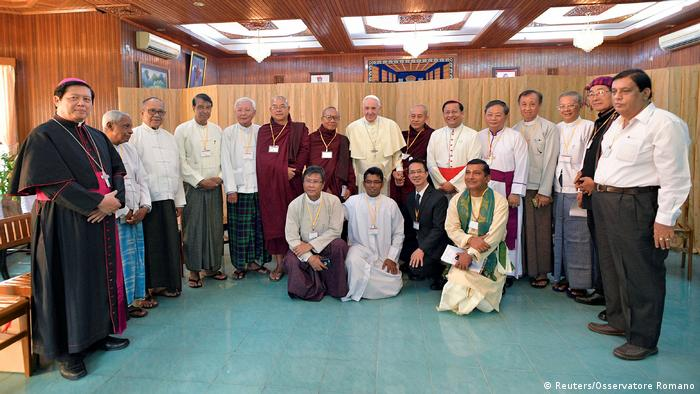 Pope Francis stands with other religious leaders during his visit to Myanmar
