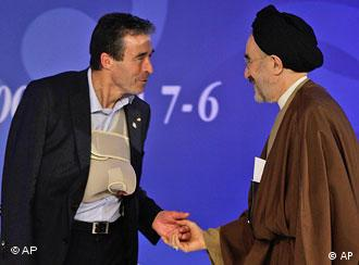 Incoming NATO General Secretary Anders Fogh Rasmussen, left, greets former Iranian President Ayatollah Mohammad Khatami in Istanbul.