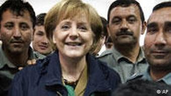 Chancellor Angela Merkel, visiting a group of Afghan police cadets in 2009