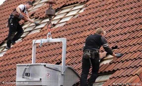 Roofers at work on a building