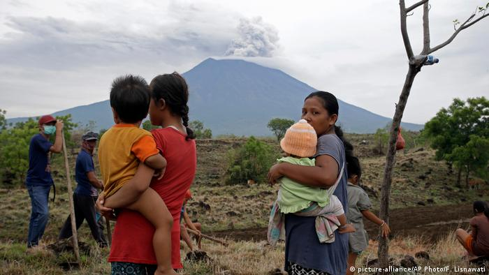 Bali women and children observe the volcanic eruption