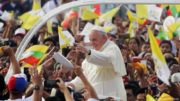 The pope waves to worshippers