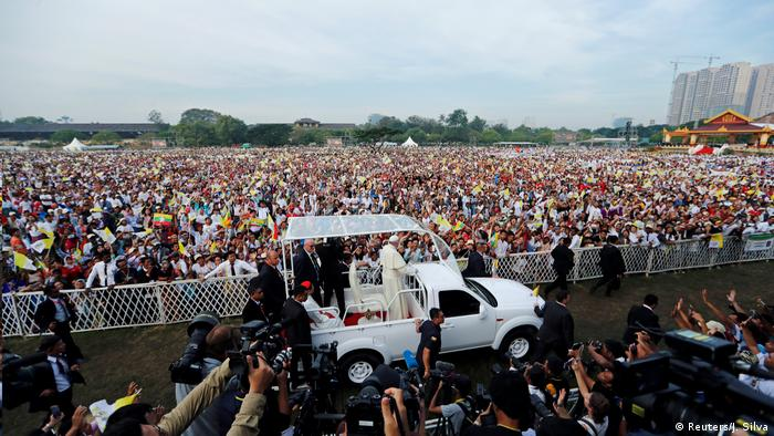 Thousands of people wait for the pope to arrive