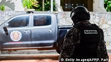 Members of the Bolivarian National Intelligence Service (SEBIN) stand guard in front of the house of the mayor of Caracas, Antonio Ledezma -who had been arrested and jailed in February 2015 after being accused of plotting to overthrow the president- in Caracas on November 17, 2017. Ledezma, who was under house arrest following surgery, managed to escape and entered Colombian territory by land, over the Simon Bolivar international bridge Colombia's migration department said. / AFP PHOTO / FEDERICO PARRA (Photo credit should read FEDERICO PARRA/AFP/Getty Images)