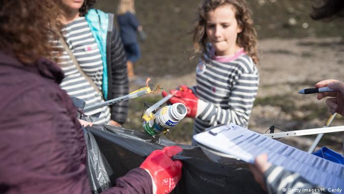Volunteers help to clean up plastic on a UK beach