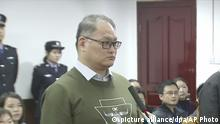 In this image taken from video released on Nov. 28, 2017, by the Intermediate People's Court of Yueyang, Taiwanese activist Lee Ming-che, left, and his fellow defendant Peng Yuhua of China stand during a court session at the Intermediate People's Court of Yueyang in Yueyang in central China's Hunan Province, Tuesday, Nov. 28, 2017. China sentenced Lee to five years and Peng to seven years in prison Tuesday for holding online political lectures and helping the families of jailed dissidents in a conviction demonstrating how Beijing's harshest crackdown on human rights in decades has extended beyond the Chinese mainland. (Intermediate People's Court of Yueyang via AP Video) |
