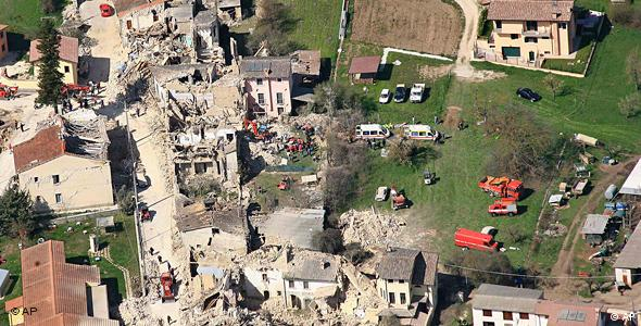 An aerial shot showing the rubble of collapsed buildings in L'Aquila