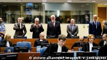 Jadranko Prlic, second left, Bruno Stojic, Slobodan Praljak, Milivoj Petkovic and Valentin Coric enter the Yugoslav War Crimes Tribunal in The Hague, Netherlands, Wednesday, Nov. 29, 2017, to hear the verdict in the appeals case. A United Nations war crimes tribunal is handing down its last judgment, in an appeal by six Bosnian Croat political and military leaders who were convicted in 2013 of persecuting, expelling and murdering Muslims during Bosnia's war. Wednesday's hearing is the final case to be completed at the groundbreaking International Criminal Tribunal for the former Yugoslavia before it closes its doors next month. (Robin van Lonkhuijsen,Pool Photo via AP) |