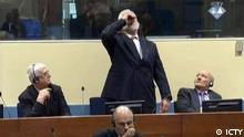 THE HAGUE, NETHERLANDS - NOVEMBER 29: Photo provided by ICTY shows, Crotian Former General Slobodan Praljak drinking a small bottle of liquid claimed to be poison after judges reconfirmed his 20-year prison sentence during a Yugoslav War Crimes Tribunal in The Hague, Netherlands on November 29, 2017. ICTY / Anadolu Agency | Keine Weitergabe an Wiederverkäufer.